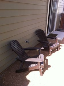 Relax in wood adirondack chairs on the side porch!