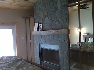 Beautiful Natural Muskoka Rock fireplace.  His & Hers Armoire Closets .