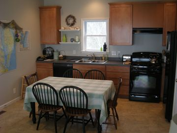 Well-stocked, eat in kitchen with all the amenities.