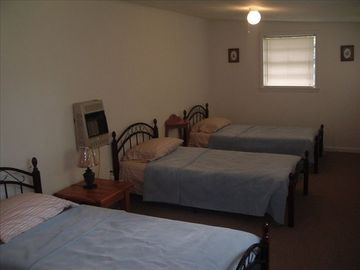 3 single beds in seperate heated and cooled bedroom.