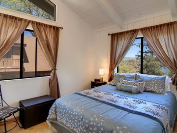 Two queen bedrooms with vaulted ceilings provide privacy for couples