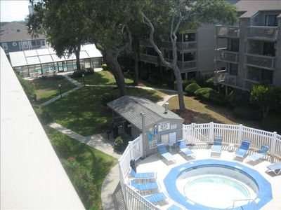 Balcony overlooks hottub and indoor pool to left