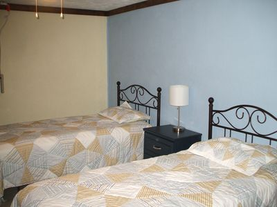 2nd lower level bedroom sleeps 2 & own access to lower deck.