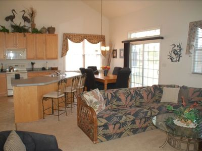 Kitchen, dining area and great room with slider to screened porch.