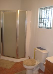 Upstairs bathroom with glass-doored shower