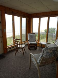 Enclosed front porch - great place to enjoy the view & your morning cup of coffe