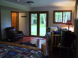 Bigfork cabin photo - Downstairs bedroom looks out on Swan River through French Doors