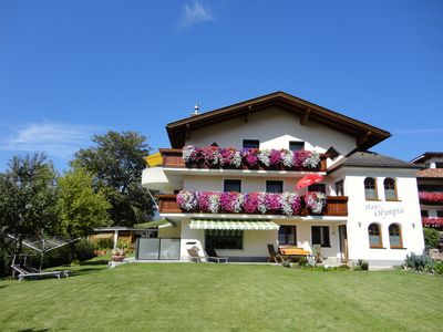 Apartments House Olympia Lans - Innsbruck with it's large garden for the guests