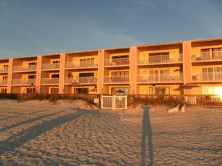 Indian Rocks Beach condo photo - CONDO BULIDING, POOLDECK AND POOL BEHIND FENCE