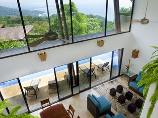 Dominical villa photo - Living and dining rooms, coastal view from second floor hallway btwn bedrooms