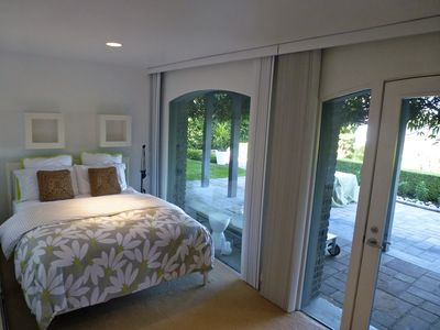 Seattle house rental - Queen bed, garden level bedroom with access to patio, water views.