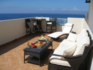 Aguadilla condo photo - Terrace with Comfortable Furnitue