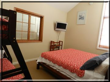 Upstairs bedroom with king, bunk with double/twin overlooks great room below.