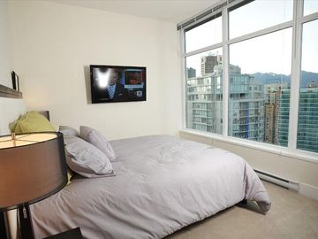 2nd Bedroom - queen size bed, TV, view of coal harbour, mountains, water, city