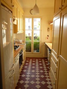 the incredibly bright & well-equipped kitchen, with the original tiled floor