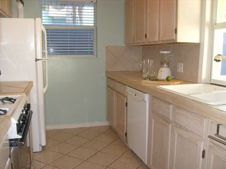Fully stocked kitchen with gas range. - Siesta Key house vacation rental photo