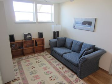 Sitting Room/4th BR. The sofa has a double bed. Two doors close for privacy.
