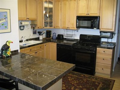 Kitchen with Marble Countertops has Every Convienence of Home
