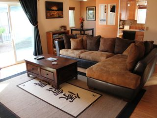 Bend condo photo - Sectional sofa w pull out. Pop up coffee table.