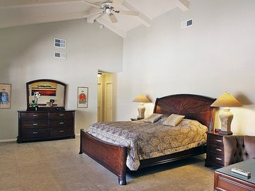 Transitional Style Bedroom (1st) with King Bed, Walk-in Closet & Bathroom (1st).