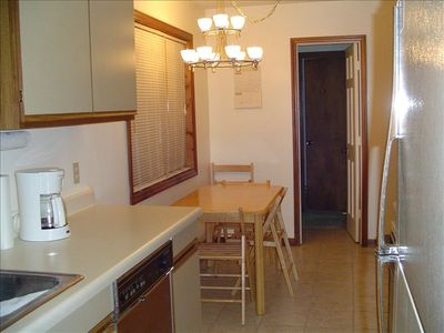 Beech Mountain chalet rental - alternate view of kitchen and dining. Cabin also has a dining bar& tv trays