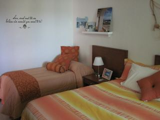 Isla Mujeres condo photo - 2nd bedroom, one king and one twin both with memory foam toppers
