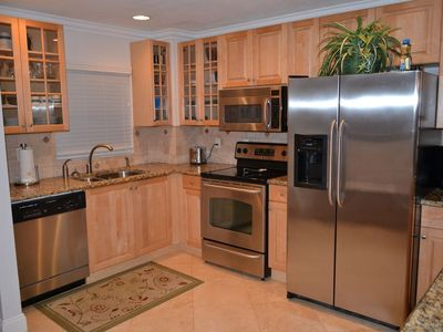 Gorgeous Kitchen with stainless steel appliances, granite, and bright decor.