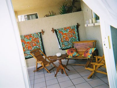 Patio off of living area -charcoal grill steps from sand, waters of HalfmoonBay