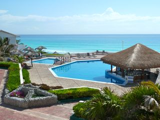 Cancun condo photo - adult and childrens pools