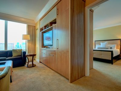 Step into the master bedroom from the living room.