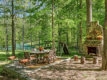 Perfect spot for dinner, s'mores or entertaining. Small kids play structure