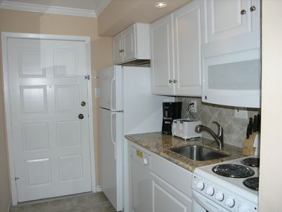 Kitchenette has all new appliances. Full size refridgerator. Granite counter!