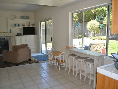 Family room to outdoor living area. Kitchen bar table & kids table.