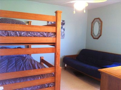 XL Twin bunks and a full-sized futon in one bedroom