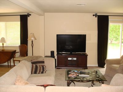 Living room looking to the back yard, 55 inch TV w/sound bar DVD stereo system