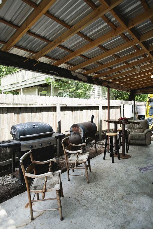Back patio complete with grill and smoker, great for dining al fresco!