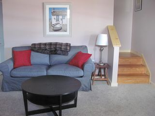 Manchester house photo - Sleeper sofa in lower level family room, with direct access to the outside!