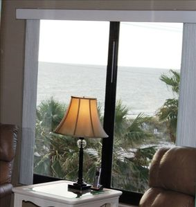 Enjoy A beverage & watch the beach from new leather recliners!