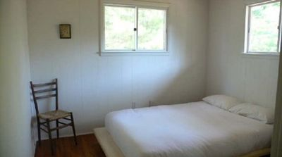 Bedroom 2, double bed, large closet, blinds on windows. Identical to bedroom 1.