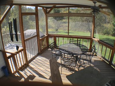 Guests love our attached 4 sided screened room overlooking the rear pasture!