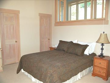 Master bedroom with bathroom; queen bed