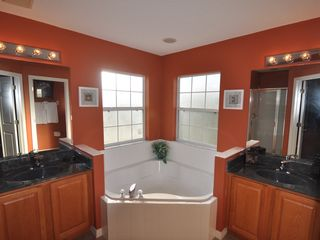 Emerald Island house photo - Master Bathroom 1 - 2 sinks, garden tub, separate shower