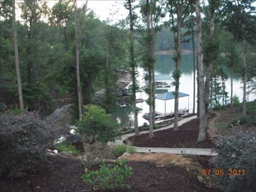 View of dock from lower level of home. Paved sidewalk to dock w/fire pit!