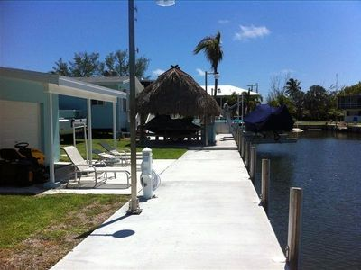 SEAWALL AND TIKI HUT WITH OUTDOOR KITCHEN