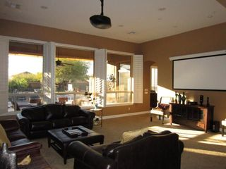 Scottsdale house photo - Projection TV in formal living room. Lots of seating and a queen size pullout.