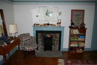 Newport house photo - Fireplace in the twin room.