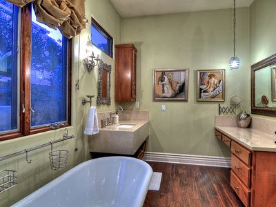 Two large sinks, artwork and beauty surround you.