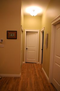Hallway to laundry, bedrooms and bathroom