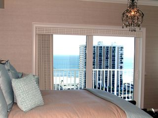 Daytona Beach Shores condo photo - Master Bedroom with balcony overlooking Beach and Ocean!