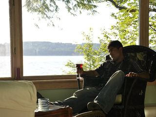Cabana boy taking a break on porch - Canandaigua cottage vacation rental photo